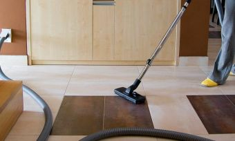 Person vacuuming house