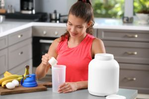 Woman making protein shake
