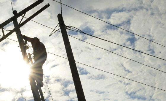 man working on power lines