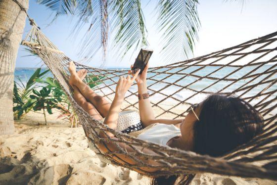 Happy woman with white bikini, hat and sunglass