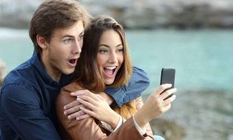 couple watching a smart phone on holidays