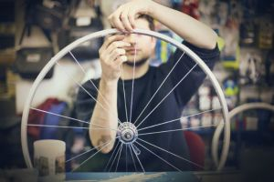 man fixing bike tyre
