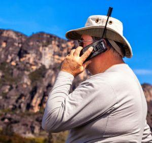 man using satellite phone