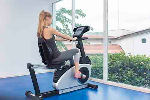 woman on bike exercising