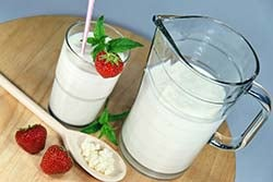 Jug and glass of kefir,