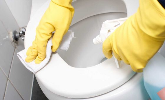 cleaning a toilet