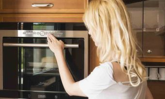 lady looking at oven