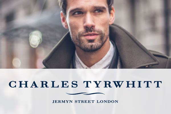 Charles Tyrwhitt logo over a picture of a fashionable man wearing a long jacket.