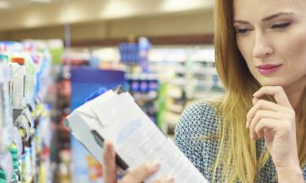 Shopper reading label