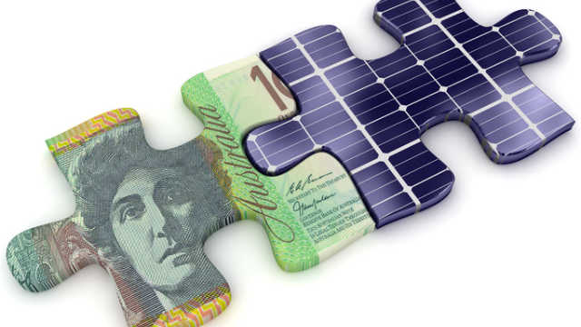 money and solar panel puzzle pieces