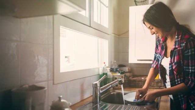woman doing the dishes in her kitchen