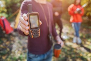 Man holding satellite phone