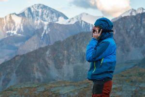 Man using satellite phone in wilderness
