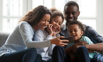 Young family with mobile phone