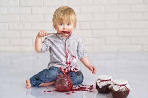 kid eating jam on floor