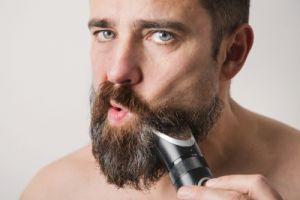 bearded-man-cutting-beard