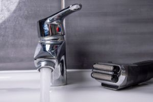 Shaver next to the tap on the washbasin