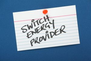 A reminder to Switch Energy Provider written on a note card