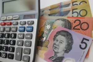 Budgeting for future, Australian currency and calculator