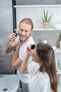 happy husband shaving his beard