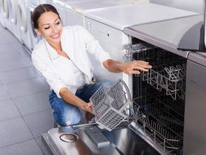 lady emptying dishwasher