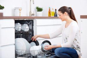 woman emptying dishwasher