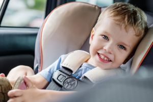 portrait happy toddler boy sitting