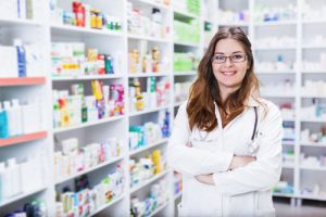 Pharmacist chemist woman standing