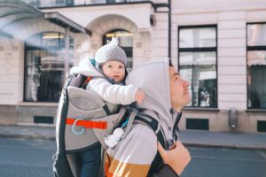 Father with child son in carrier backpack