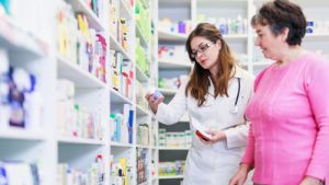 Female pharmacist discusses prescription