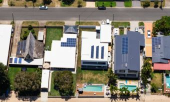 Bird's eye view of homes with solar panels
