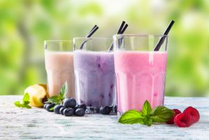 Fresh milk, raspberry, blueberry and banana drinks