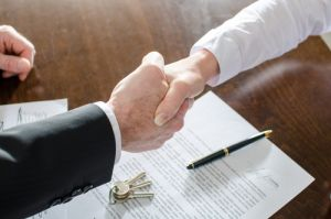 Estate agent shaking hands
