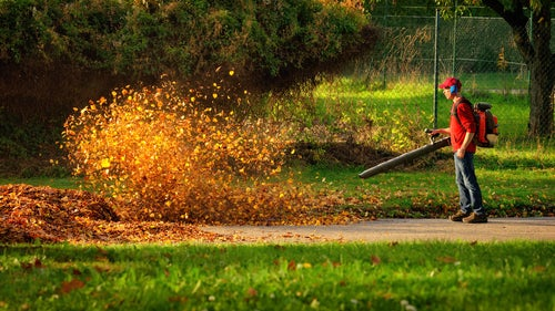 Man operating a heavy duty leaf blower