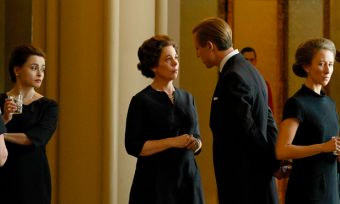 Still shot from The Crown season three with royal family dressed in black