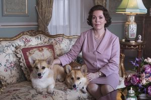 The Crown season three with Queen sitting down with two Corgis