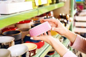 woman selecting bowl in pet shop