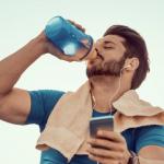 man_drinking_protein_shake_on_steps