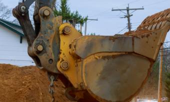 Excavator digging home