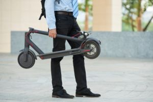 Businessman Holding Scooter