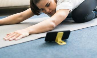 Woman doing yoga on phone