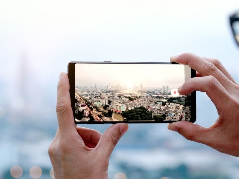 A person taking a photo with their camera smartphone
