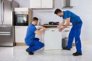 installing dishwasher two men