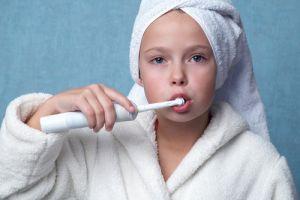 white bathrobe cleaning teeth
