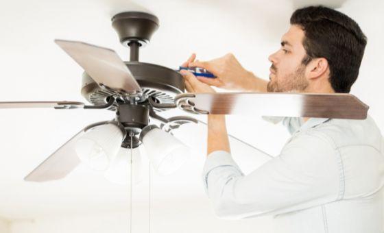man installing ceiling fans