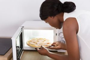 Close-up-Of-A-Young-Woman-Baking-Pizza
