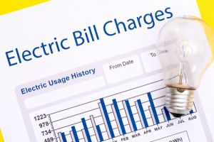 Electricity bill with light bulb in front