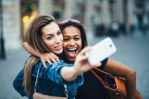 Women taking Snapchat selfie