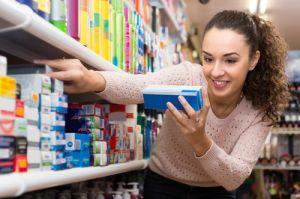 girl buying toothpaste