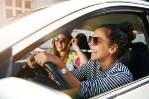 girls driving in a car